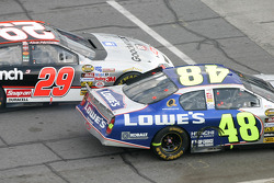 Jimmie Johnson and Kevin Harvick battle exiting pit road