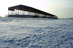 Snow by a grandstand