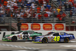 Carl Edwards takes the checkered flag ahead of Jimmie Johnson