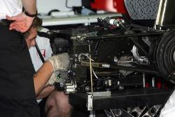 BAR-Honda team members repair gearbox on Takuma Sato's car
