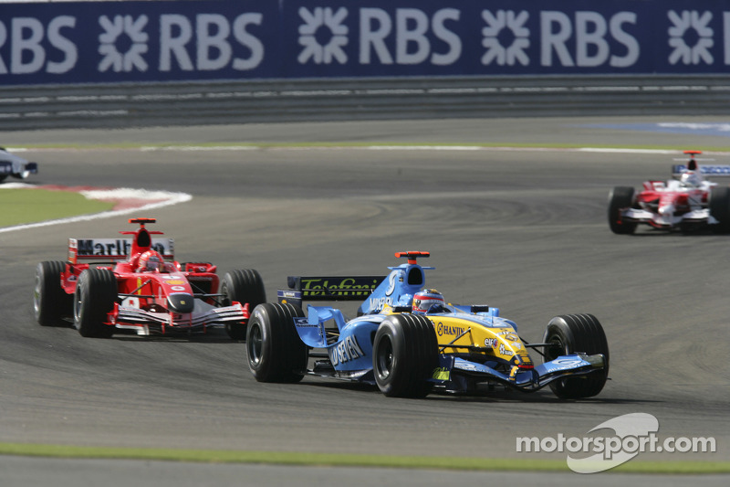 Fernando Alonso leads Michael Schumacher