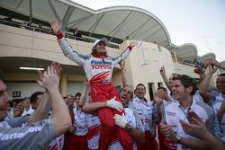 Jarno Trulli celebrates with Toyota team members
