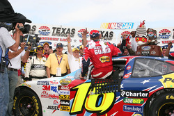 Victory lane: race winner Greg Biffle climbs from his car