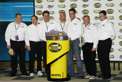 The winner's trophy sits in victory lane
