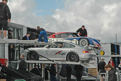 Crews unload cars and material