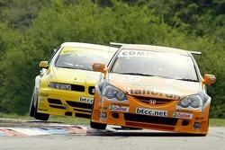 #8 Dan Eaves of Team Halfords holds of Seat Sport UK's #11 car of Jason Plato