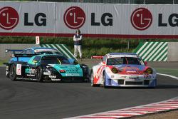 #66 Gruppe M Racing Porsche 996 GT3 RSR: Marc Lieb, Mike Rockenfeller, #10 Vitaphone Racing Team Maserati MC 12 GT1: Thomas Biagi, Fabio Babini