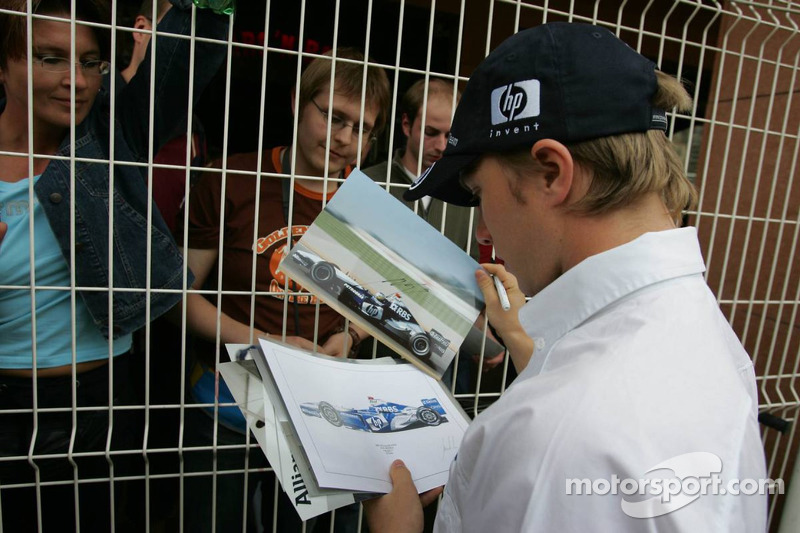 Nick Heidfeld signs autographs