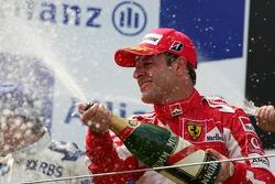 Podium: champagne for Rubens Barrichello