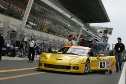 Max Papis with Corvette Racing team members back from scrutineering
