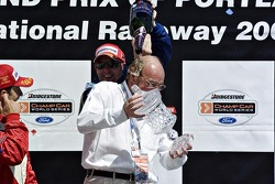 Paul Tracy congratulates Kevin on his teams victory
