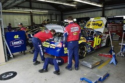 The National Guard team works on the #16 Ford