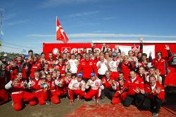 Race winners Sébastien Loeb and Daniel Elena celebrate with Citroën Sport team members