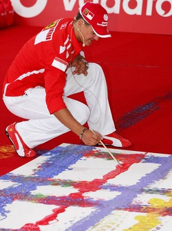 Vodafone event at Hockenheim Talhaus: Michael Schumacher signs his artwork