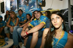 Fernando Alonso in charming company at the new Renault F1 hospitality area