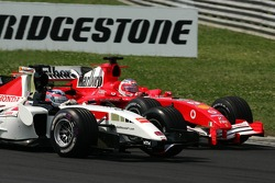 Takuma Sato and Rubens Barrichello battle