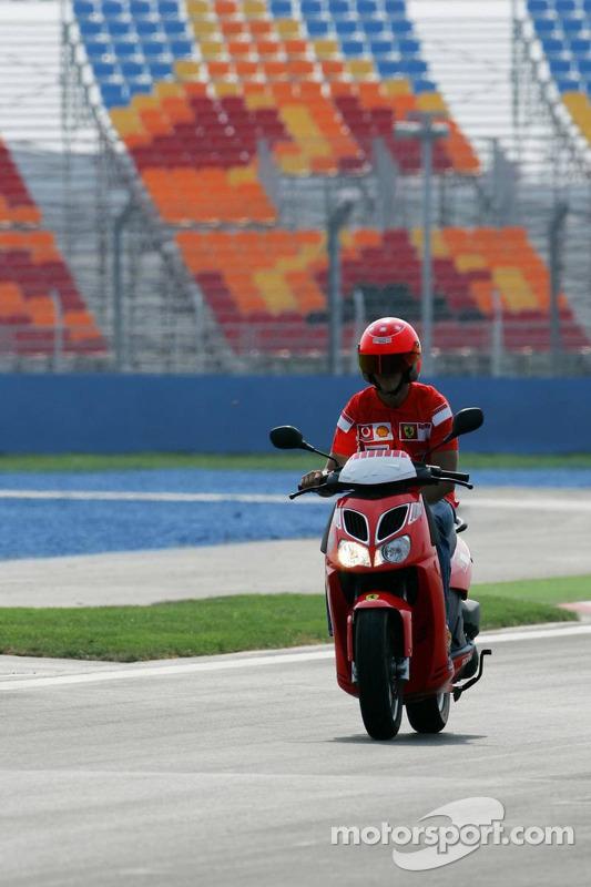 Michael Schumacher inspects the track
