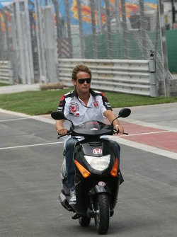 Jenson Button inspects the track