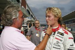 Pole winner Nico Rosberg celebrates with dad Keke