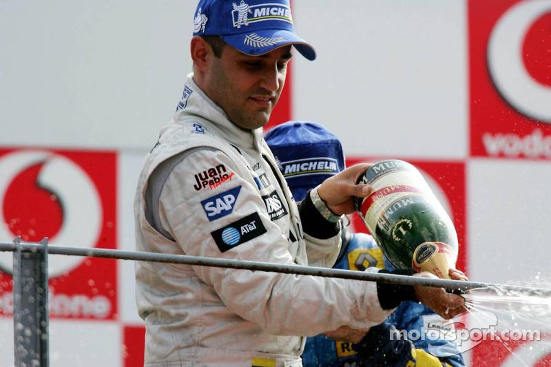 Podio: champagne para el ganador de la carrera Juan Pablo Montoya