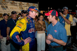 Kyle Busch is congratulated by Jeff Gordon