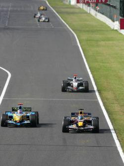 Fernando Alonso passes Christian Klien