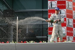 Podium: champagne for Kimi Raikkonen