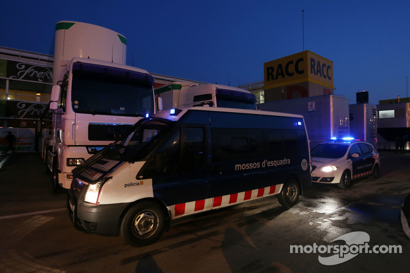 Police vehicles arrive in the paddock