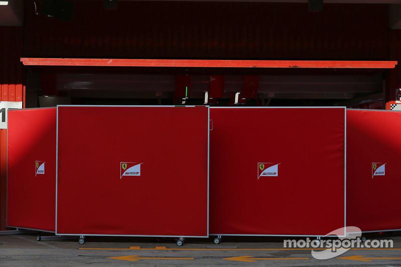 Screens up at the Ferrari pit garage