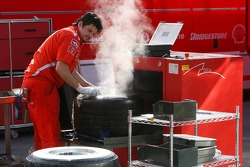 Ferrari team member washes tires