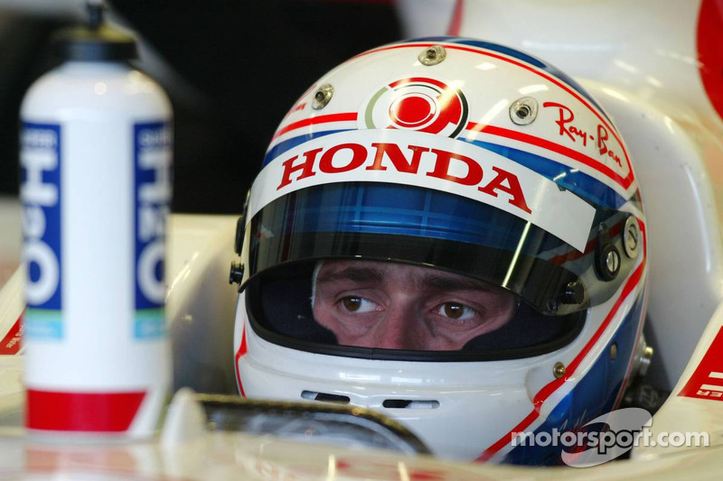 Adam Carroll (wearing the helmet of Anthony Davidson)