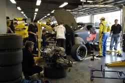 Elliott Sadler looks on as his crew changes an engine