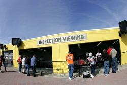 Fans watch tech inspection