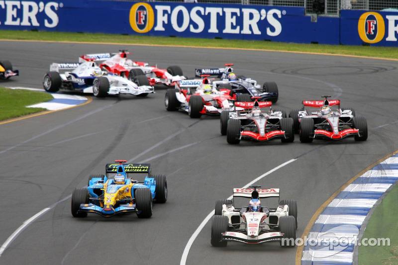 First corner: Jenson Button leads Fernando Alonso while Juan Pablo Montoya and Kimi Raikkonen battle