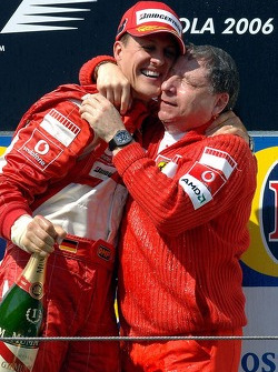 Podium: race winner Michael Schumacher with Jean Todt