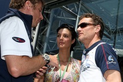 Press officer Thomas Hofmann and David Coulthard with his girlfriend Karen Minier