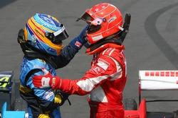 Race winner Michael Schumacher celebrates with Fernando Alonso