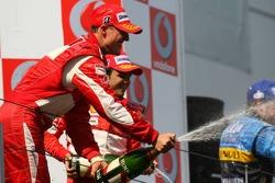 Podium: champagne for Michael Schumacher, Fernando Alonso and Felipe Massa