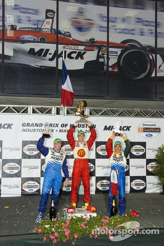 Podium: Sébastien Bourdais avec Paul Tracy et Mario Dominguez
