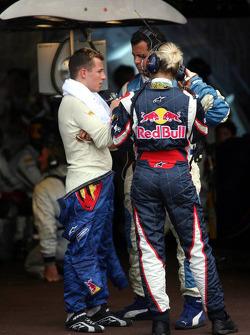 Christian Klien speaks with crew members after retiring