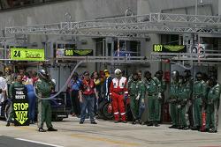 Aston Martin Racing team members wait for the #009 car