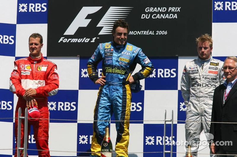 Podio: ganador de la carrera Fernando Alonso segundo lugar Michael Schumacher y tercer lugar Kimi R