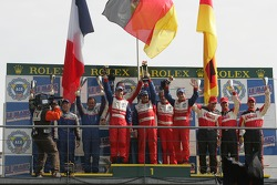 LMP2 podium: class winners Thomas Erdos, Mike Newton and Andy Wallace, with second place Bill Binnie, Allen Timpany and Yojiro Terada, and third place John Macaluso, Ian James and James Gue