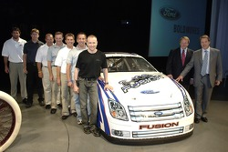 Bill Ford and Edsel Ford with Ford's NASCAR NEXTEL Cup drivers at an employee pep rally at Ford World Headquarters