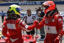 Pole winner Michael Schumacher celebrates with Felipe Massa