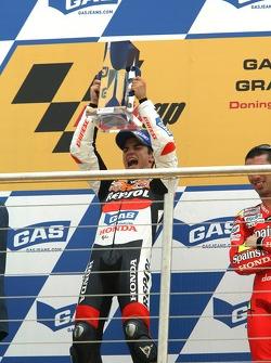 Podium: race winner Dani Pedrosa celebrates
