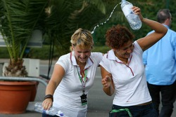 Red Bull hospitality girls have fun wit bottles of water