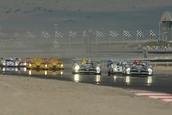 #1 Audi Sport North America Audi R10 TDI Power: Frank Biela, Emanuele Pirro in the lead at the start approaching turn 1
