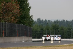 #1 Audi Sport North America Audi R10 TDI Power: Frank Biela, Emanuele Pirro, #16 Dyson Racing Team Lola B06/10 AER: James Weaver, Butch Leitzinger