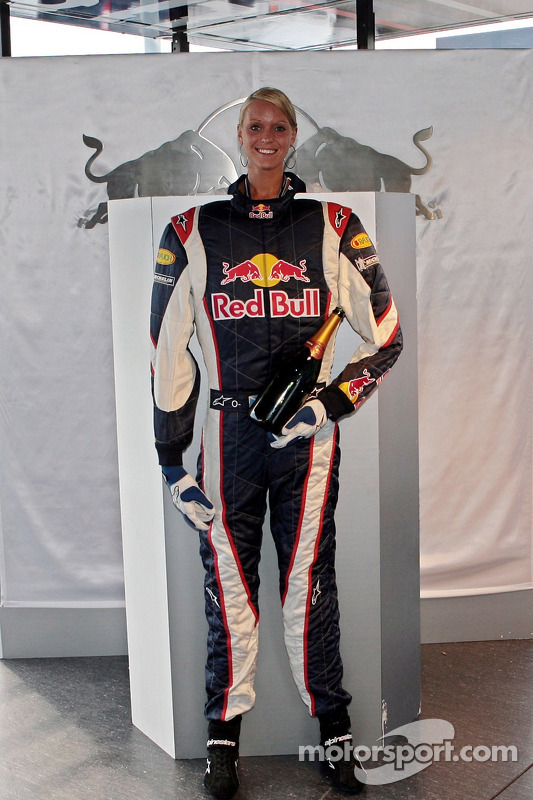 Bullshop: a Red Bull Racing suit with a bottle of champagne and a girl at German GP